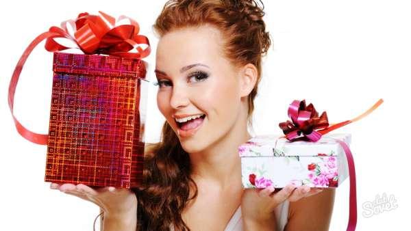 Happy laughing woman choosing between two presents