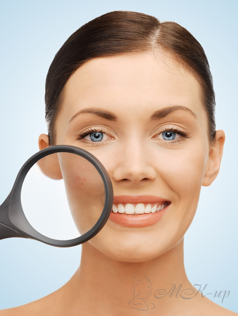 woman with magnifying glass over acne