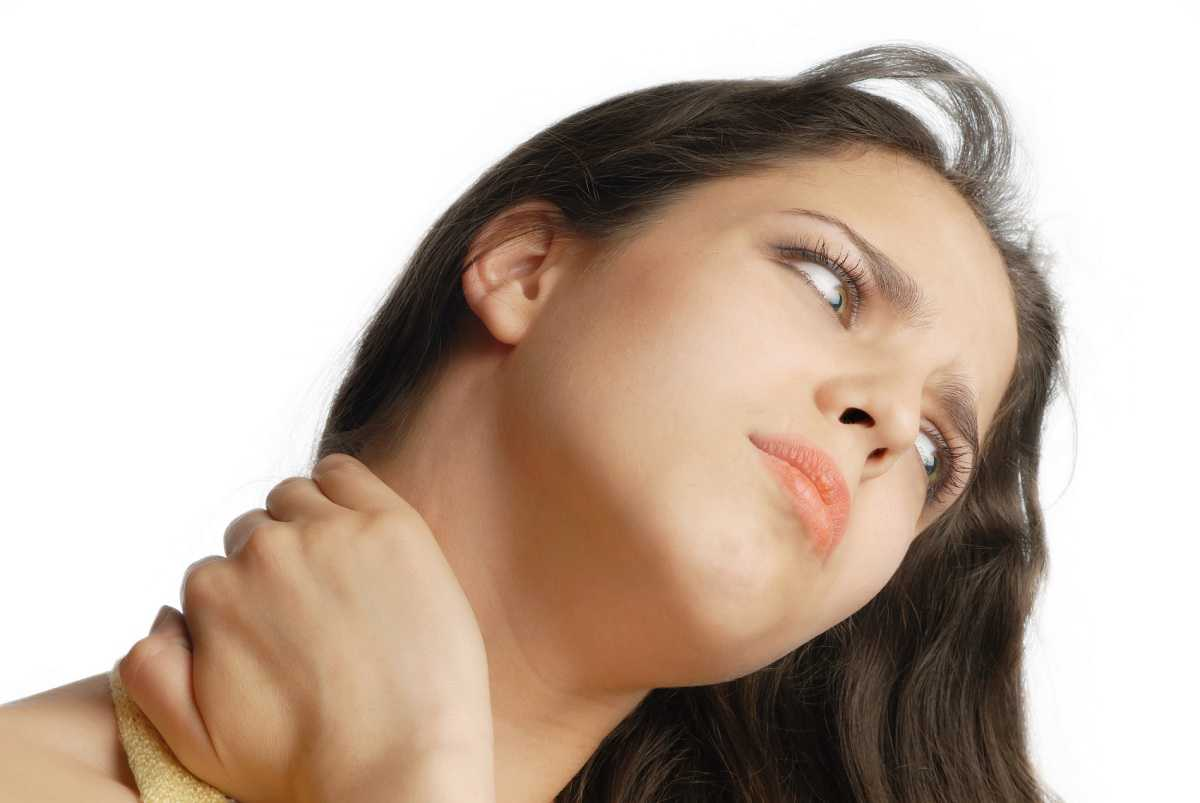 Girl suffering from the pain and massaging her neck