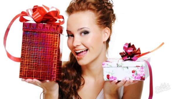 Happy laughing woman choosing between two presents